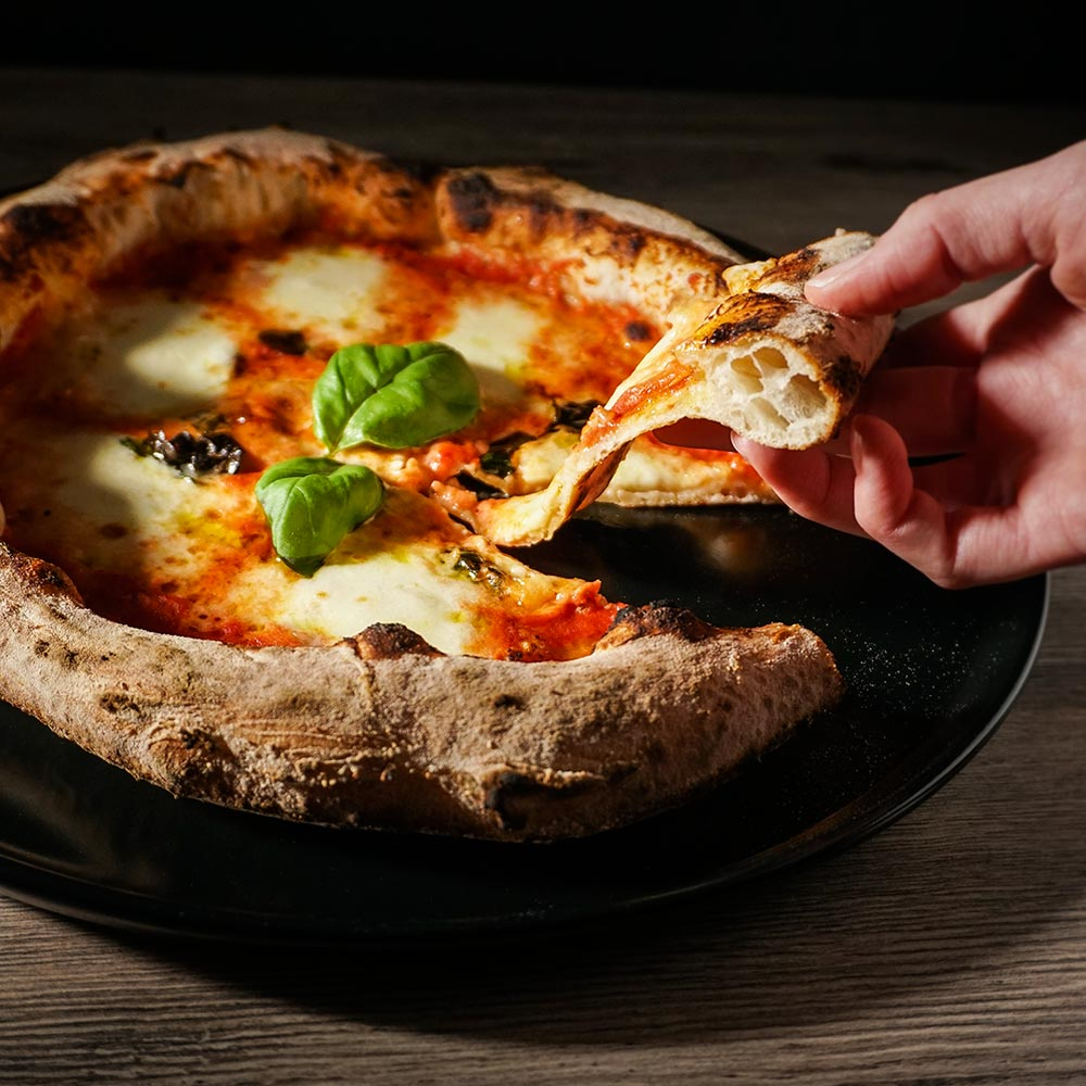 A slice of pizza Margherita (photo by Rok Jurman Design)